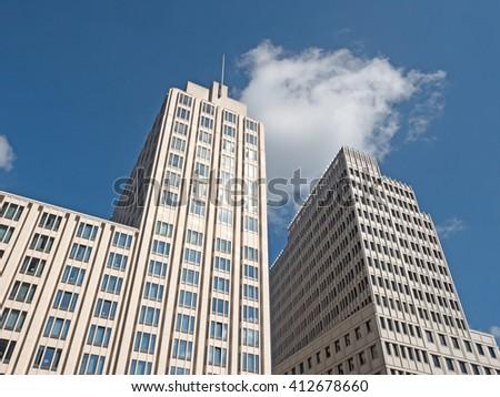 modern skyscraper under a blue sky - stock photo
