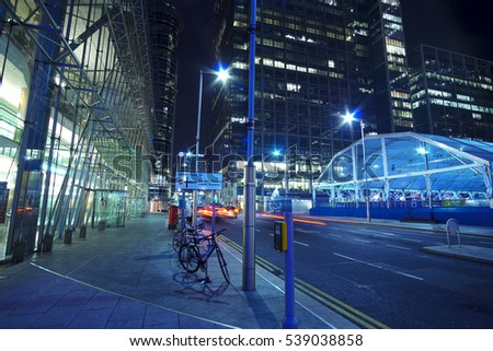 Modern skyscrapers at Canary Wharf in London - amazing night view - LONDON / ENGLAND - DECEMBER 14, 2016