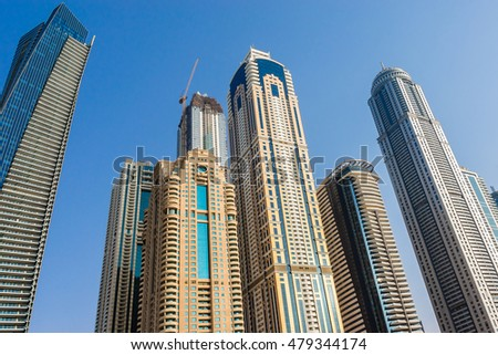 Modern skyscrapers in Dubai Marina on the Sunset. Marina - artificial canal city, carved along a 3 km stretch of Persian Gulf shoreline. United Arab Emirates.