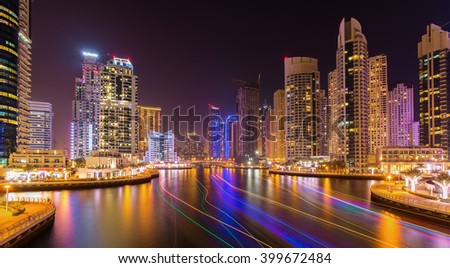 Modern skyscrapers in luxury Dubai Marina with busy promenade in the evening,Dubai,United Arab Emirates - stock photo