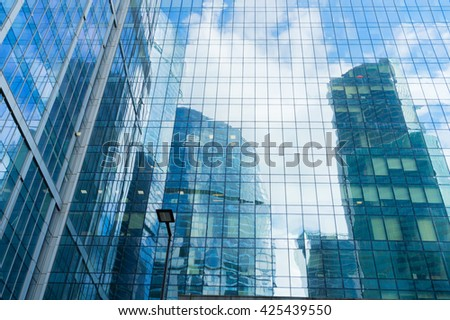 modern skyscrapers of steel and glass reflected in buildings facade - stock photo
