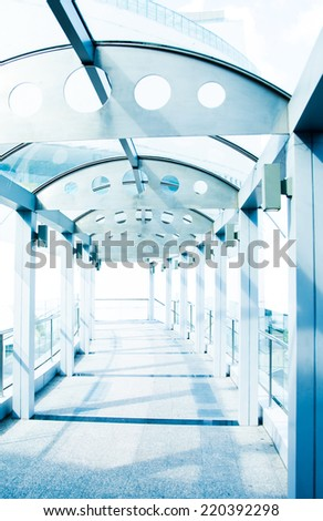 Modern skywalk made of metal stone and glass - stock photo