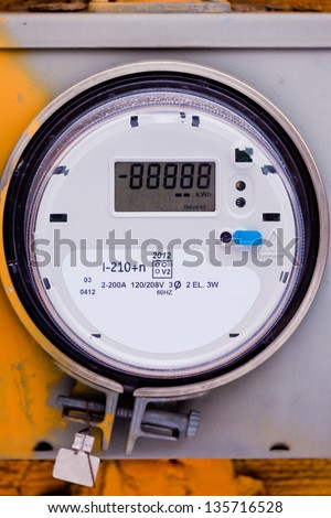Modern smart grid residential digital power supply meter on grungy base with LCD display ready to be edited for your message - stock photo