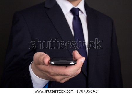 modern smart phone in young business man hand