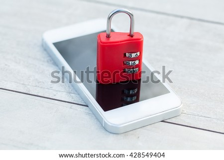 Modern smartphone with combination lock padlock. Concept of mobile phone security - stock photo