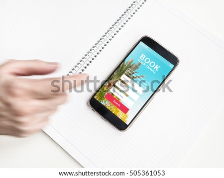 Modern Smartphone with hotel booking and travel app on screen. Motion Blurred man's hand
