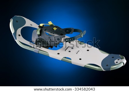 Modern snowshoe top view isolated on gradient black and blue background