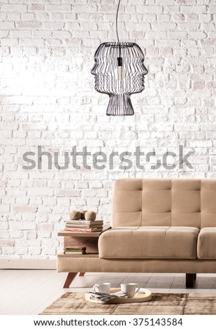 modern sofa living room with stone wall and modern lamp - stock photo
