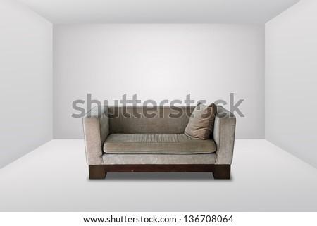 Modern sofa on the white room - stock photo