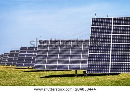 modern Solar Panels in front of blue sky
