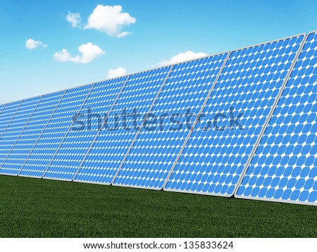 Modern Solar Panels on beautiful green grass with sun and clouds. Alternative Energy Concept - stock photo