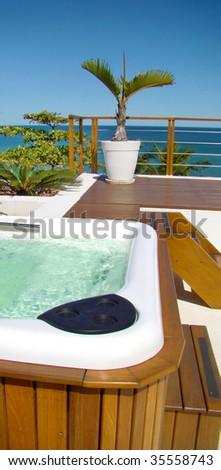 modern spa jacuzzi with a beautiful view to the sea