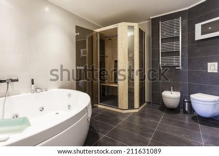 Modern spacious bathroom interior jacuzzi bath stock photo edit