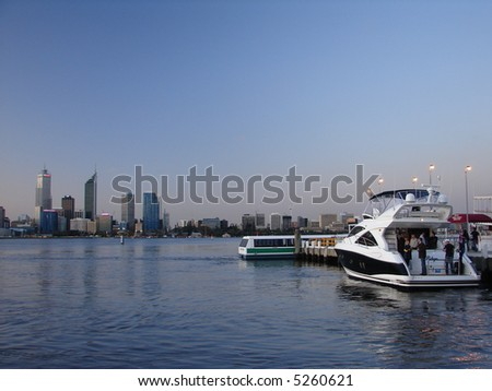 Modern speedboat parking, against modern city skyline at sunset , Australia -Perth