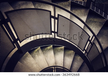 Modern spiral staircase with metallic hand-rails. LOMO effect - stock photo