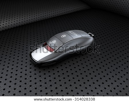 Modern sport car key on the leather seat  - stock photo