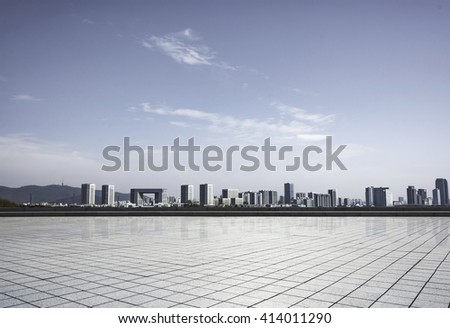 modern square with skyline and cityscape background - stock photo