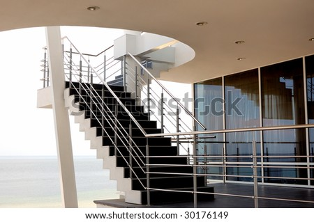 modern stairs, windows, reflections, sea and sky - stock photo