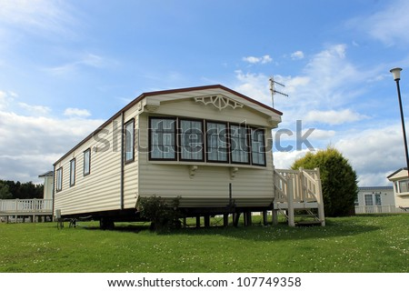 Modern static caravan on campsite during summer, holiday or vacation scene. - stock photo