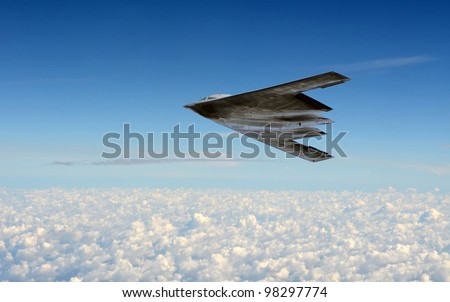 Modern stealth bomber flying at high altitude