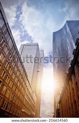 modern steel and glass office skyscrapers in the evening sun, Frankfurt am Main, Germany - stock photo