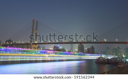 Modern steel cable-stayed bridge beams at night in Shanghai  - stock photo
