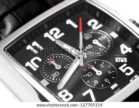 Modern steel chronograph wristwatch closeup time concept - stock photo
