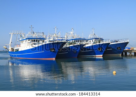 Modern steel fishing ships docked in port  - stock photo