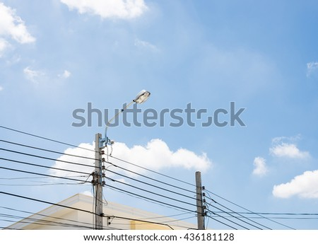 Modern street bulb on the electric pole in the city. - stock photo