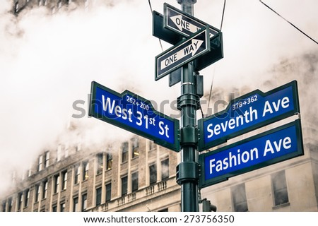 Modern street sign and vapor steam in New York City - Urban concept and road traffic directions in Manhattan downtown - American world famous capital destination on dramatic desaturated filtered look - stock photo