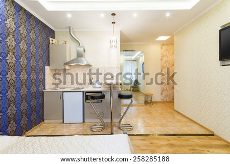 Modern Studio Apartment. Kitchen and living room. Interior design. - stock photo