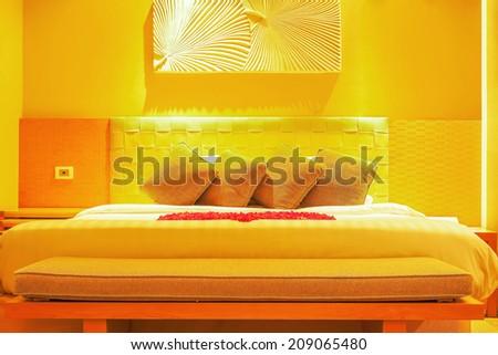 Modern Style Bedroom under romantic warm light - stock photo
