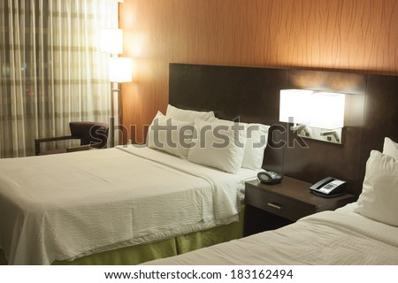 Modern Style Bedroom with Two Beds. Horizontal Image - stock photo