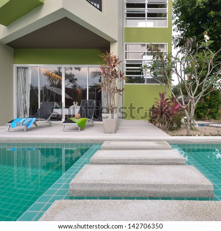 Modern style building with swimming pool. - stock photo