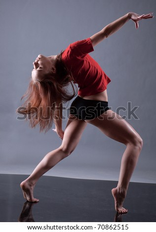 modern style dancer.female performing on  gray background