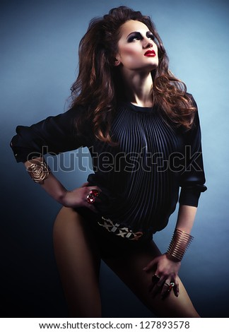 Modern style dancer girl posing on studio background. Fashion Photo.