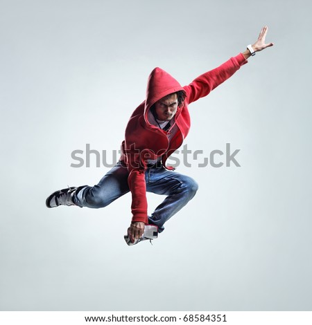 modern style dancer jumping on studio background