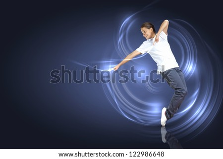 Modern style dancer posing against dark background with light effects. Illustration - stock photo