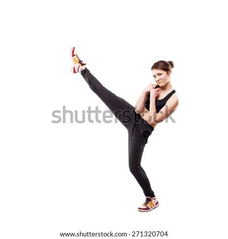 modern style dancer posing hodling leg on studio background - stock photo