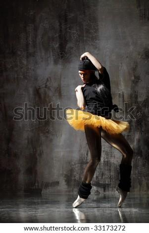 modern style dancer posing on dirty grunge background - stock photo