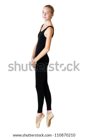 modern style dancer teen girl in black tutu posing on studio background