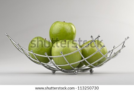 modern style fruit basket made of steel wire  ( clipping path ) - stock photo