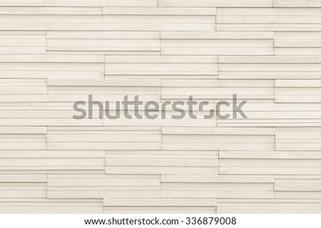 Modern style marble tile wall rough textured detailed patterned backdrop for interior decoration: Marble tiled wall linear pattern texture background in light creme/ cream beige brown color tone - stock photo
