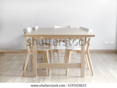 Modern Style Of Wood Dinning Table With Dinning Chairs On Wooden Floor With  White Concrete Wall