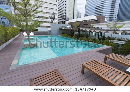 modern style swimming pool on the deck of apartment. - stock photo