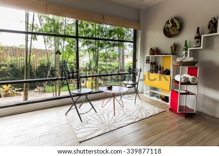 Modern styles of living room at resort in Thailand - stock photo