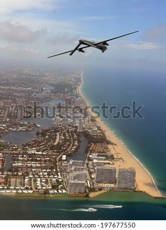 Modern surveillance drone high over the Florida coastline - stock photo