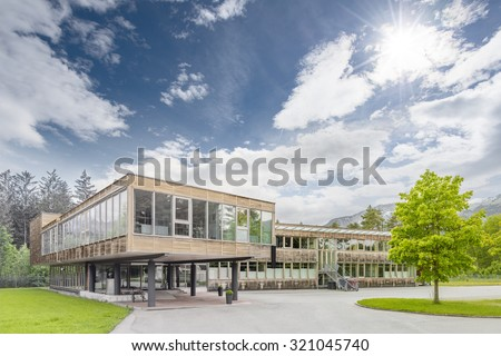 Modern sustainable and ecological timber office building - stock photo