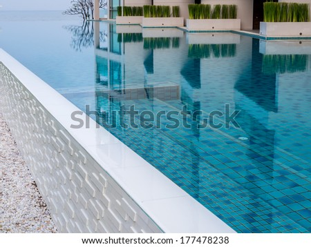 Modern swimming pool at beach residence in summer - stock photo