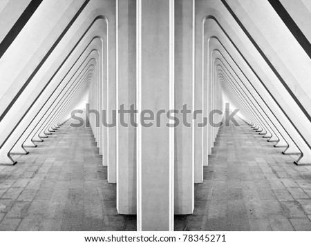 Modern symmetric tunnel in futuristic interior with concrete arches in perspective - stock photo